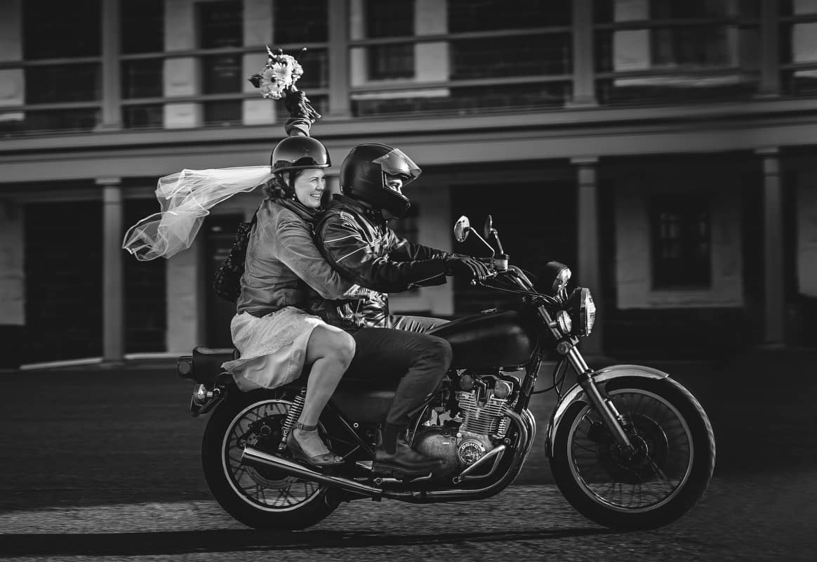 bride and groom riding a motor cycle at a halifax wedding